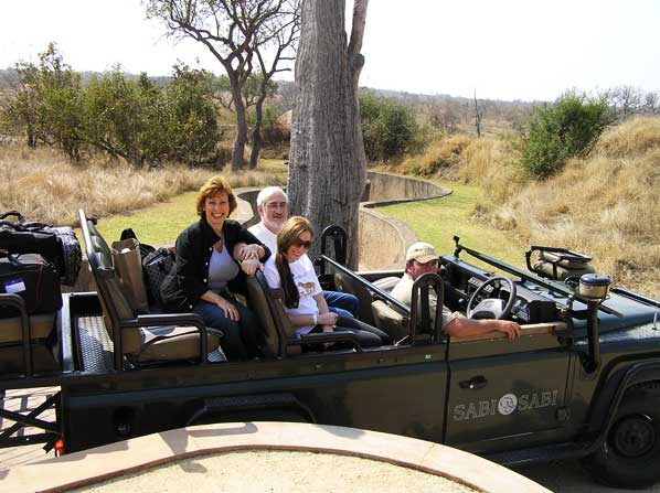 earth lodge guests on safari